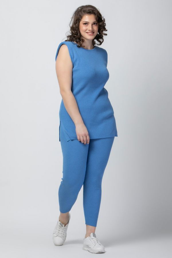Soft cotton knit long top with padded shoulders in indigo colour