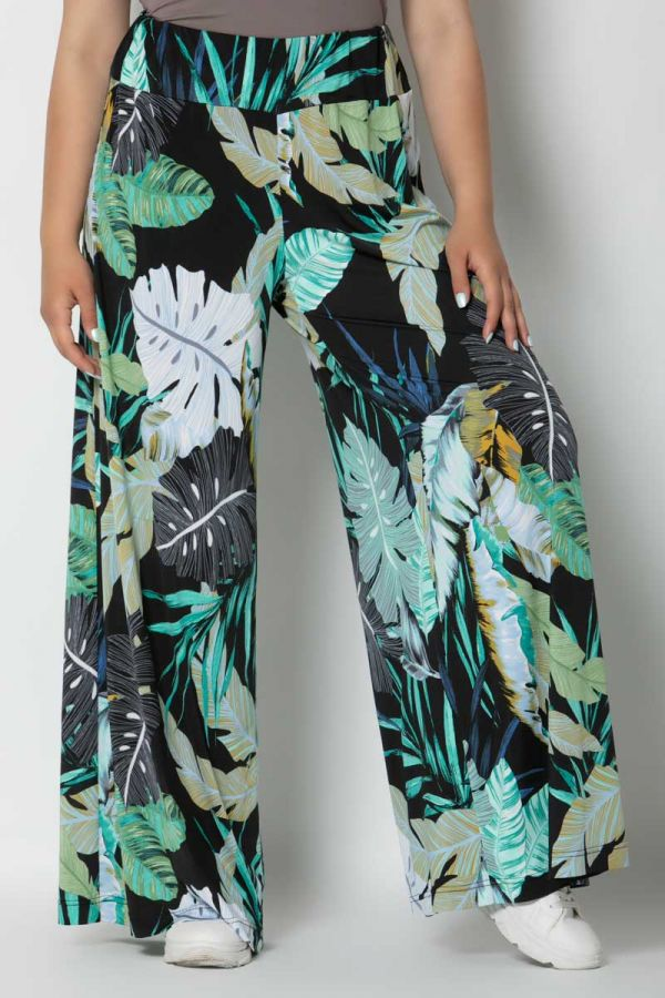 Wide leg trousers with leaves print in green colour