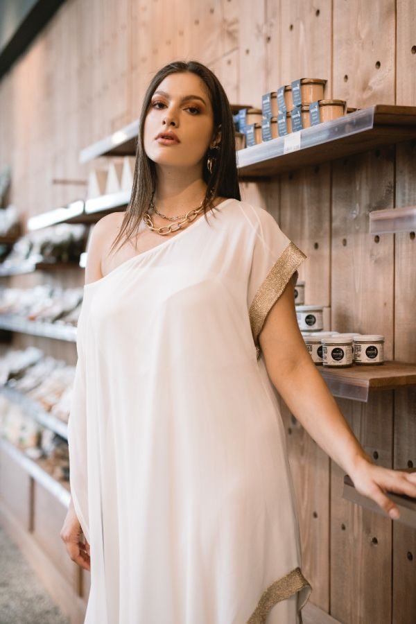 Dress with removable tunic and gold details in ecru colour