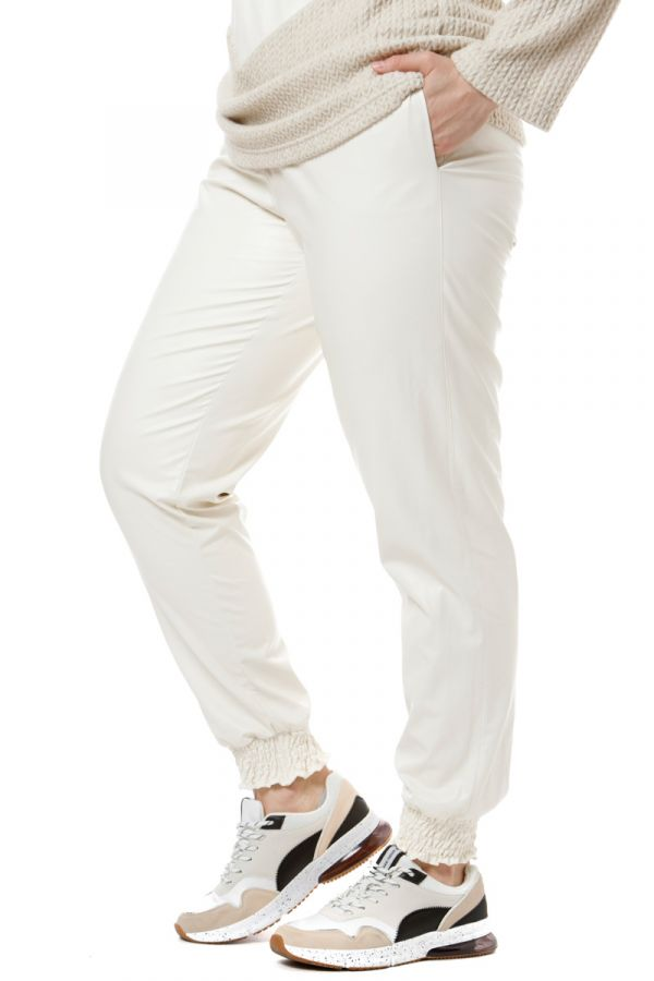 Leather-like trousers with shirred waist and cuffs in ecru colour