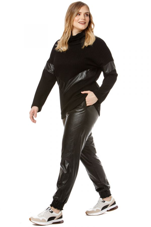 Leather-like trousers with shirred waist and cuffs in black colour